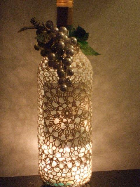 26 recycled wine bottle christmas light luminaries for Wine bottle light ideas